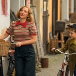 Scarlett Johansson and Roman Griffin Davis in the film JOJO RABBIT